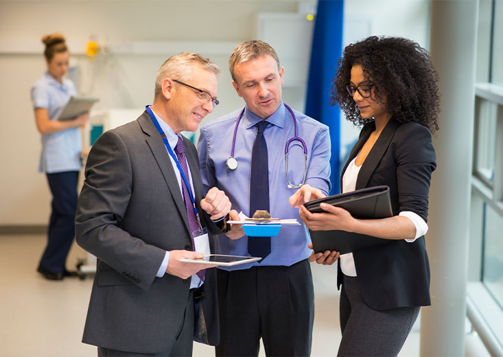 An online Master of Health Administration student consulting two doctors on their findings.