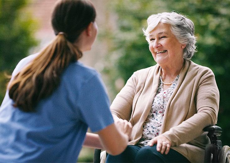 Online Mental Health Nursing Course student talking to an elderly patient.